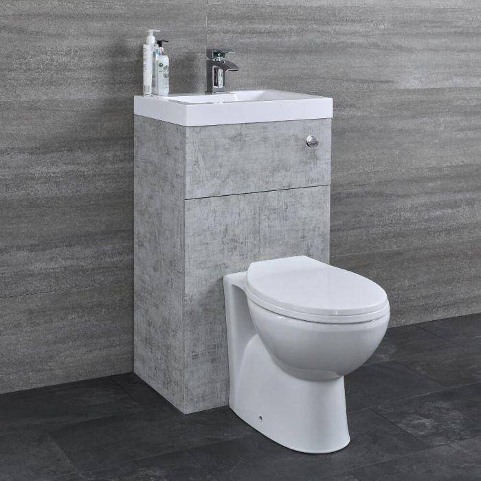 Ovale Toilette mit Spülkasten und integriertem Waschbecken Betongrau