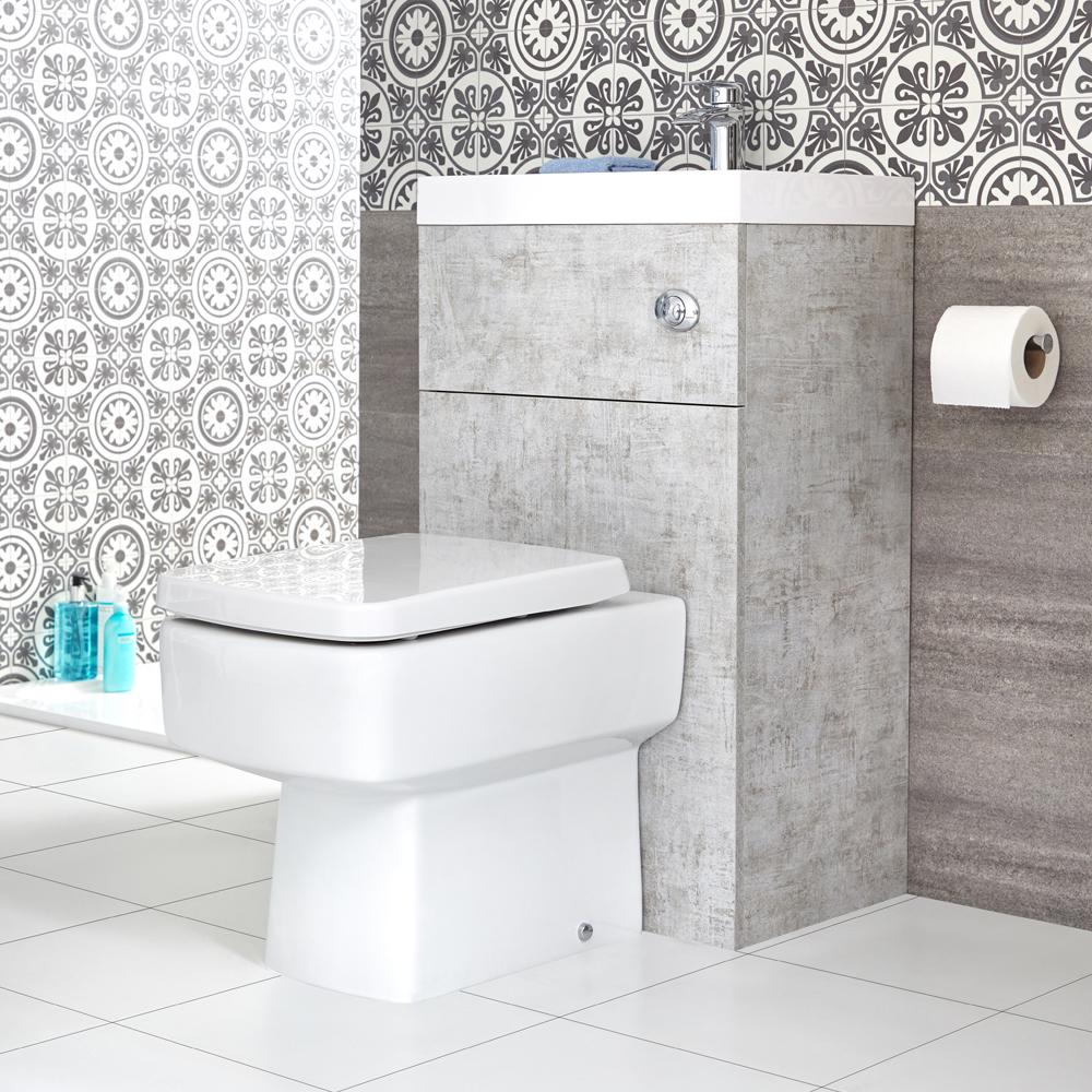 Eckige Toilette mit Spülkasten und integriertem Waschbecken Betongrau